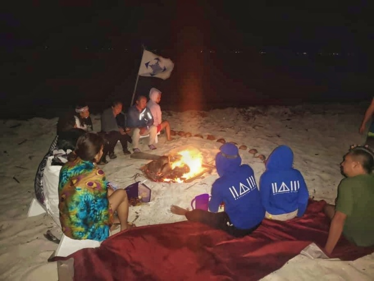 Campfires burning by the beach with good company.